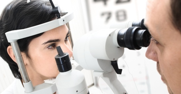 Woman with optometrist getting an eye test